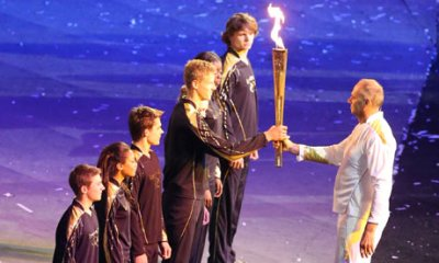 Steve Redgrave hands the torch to the seven young promising athletes